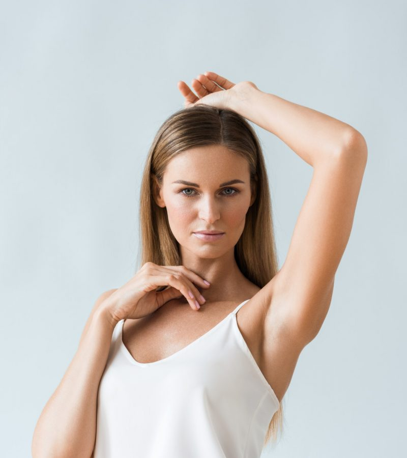 Armpit woman hand up epilation concept